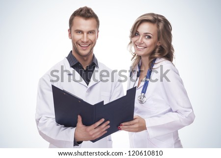 Portrait of a smiling doctors isolated on blue gradient background - stock photo
