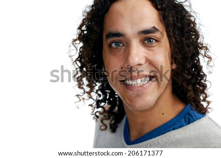 Portrait of a smiling ethnic man against a white background