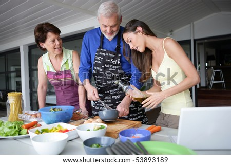 Portrait of a smiling family cooking - stock photo