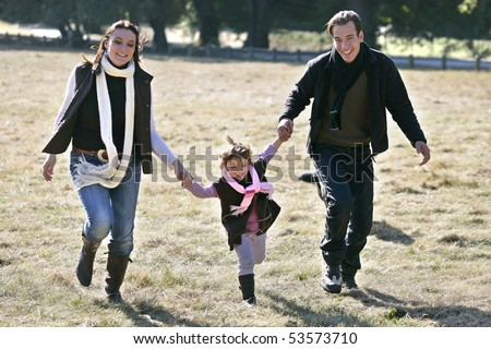 Portrait of a smiling family having a walk