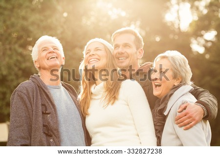 Portrait of a smiling family on an autumns day - stock photo