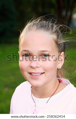 Portrait of a smiling girl - stock photo