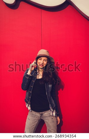 portrait of a smiling girl in a hat on bright background on a sunny day - stock photo