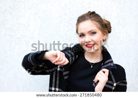 portrait of a smiling girl in high key against a white wall - stock photo