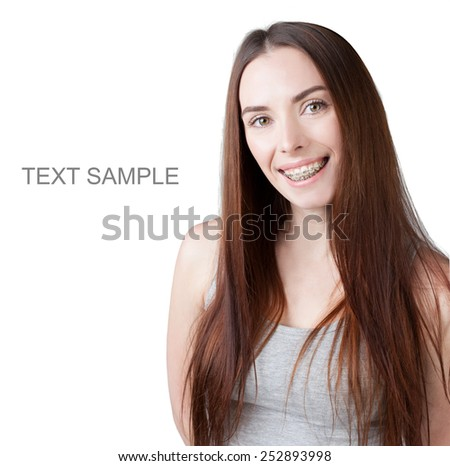 portrait of a smiling girl wearing braces. Isolated. White background.  - stock photo