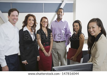 Portrait of a smiling group of multiethnic businesspeople in the office - stock photo
