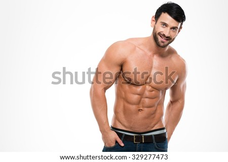 Portrait of a smiling handsome man with muscular torso standing isolated on a white background
