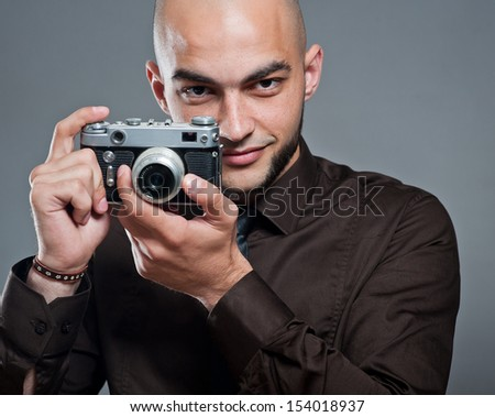 Portrait of a smiling handsome young man with camera