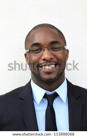 Portrait of a Smiling, Happy, and Attractive, Young Professional African American Businessman Wearing Glasses