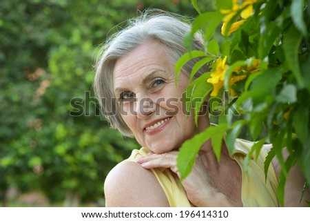 Portrait of a smiling happy senior woman on resort