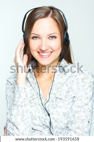 Portrait of a smiling happy woman call center operator . - stock photo