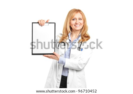 Portrait of a smiling healthcare professional holding a blank clipboard isolated on white background