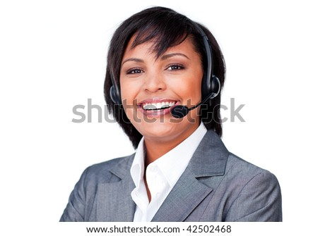 Portrait of a smiling hispanic businesswoman with headset on against a white background - stock photo