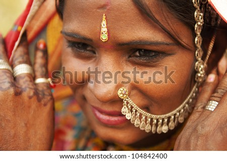 Portrait of a smiling India Rajasthani woman - stock photo