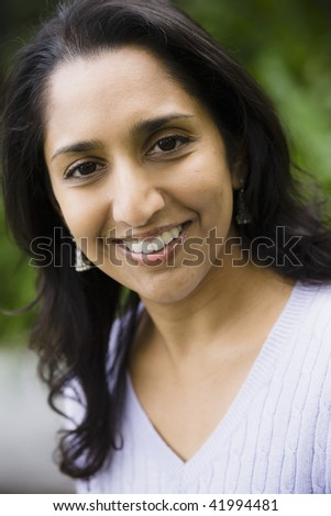 Portrait of a Smiling Indian Woman Outdoors