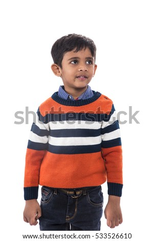 Portrait of a smiling kid looking towards copy space on white background