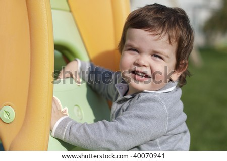 Portrait of a smiling kid on playground