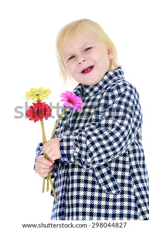 Portrait of a smiling little blond Caucasian girl in autumn coat in a cage, a girl holding in hands during flower-Isolated on white
