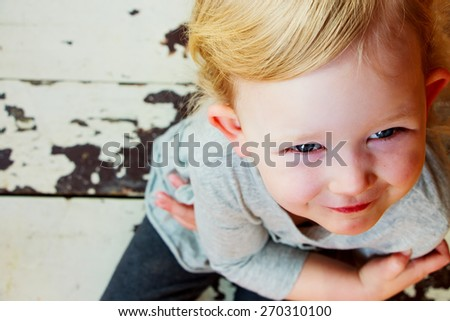 Portrait of a smiling little girl. Childhood, gesture and people. - stock photo