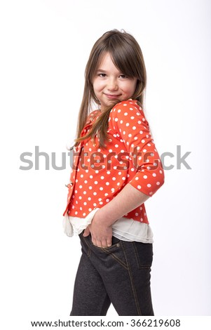 Portrait of a smiling  little girl over white background - stock photo