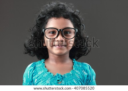 Portrait of a smiling little girl with a big spectacle - stock photo