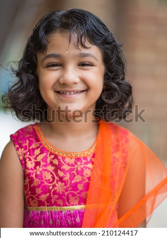Portrait of a Smiling Little Indian Girl in Ethnic Costume