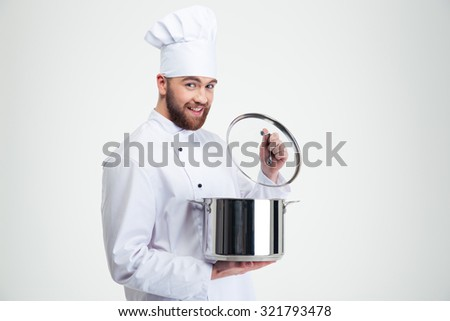 Portrait of a smiling male chef cook holding pan isolated on a white background - stock photo