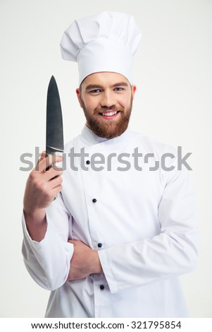Portrait of a smiling male chef cook showing knife isolated on a white background - stock photo