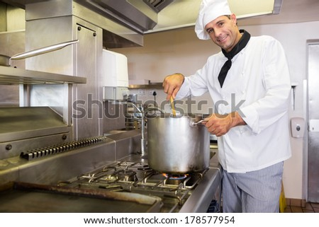 Portrait of a smiling male chef preparing food in the kitchen