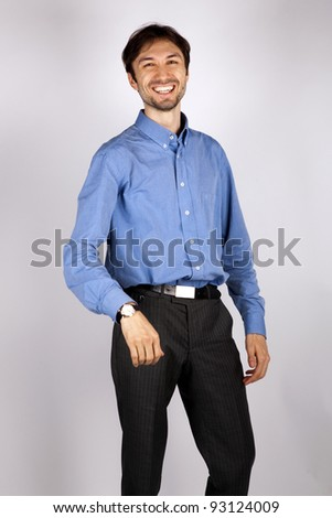 portrait of a smiling man in a blue shirt in studio - stock photo