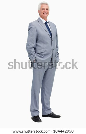 Portrait of a smiling man in a suit against white background