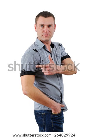 Portrait of a smiling man pointing his finger on the copyspace - stock photo