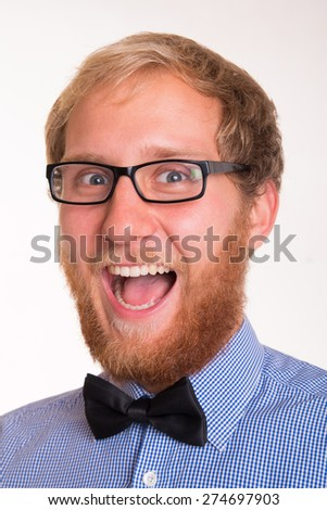 Portrait of a smiling man with a red beard and a bow tie
