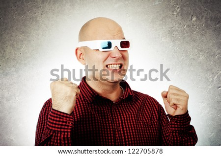 Portrait of a smiling man with anaglyph glasses enjoying a 3d movie.
