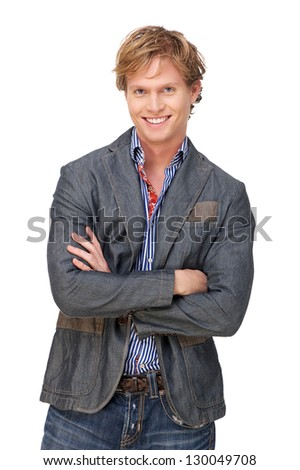 Portrait of a smiling man with arms crossed against white background - stock photo