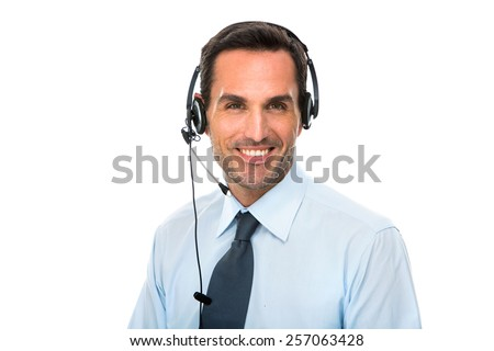 Portrait of a smiling man with headset working as a call center operator - stock photo