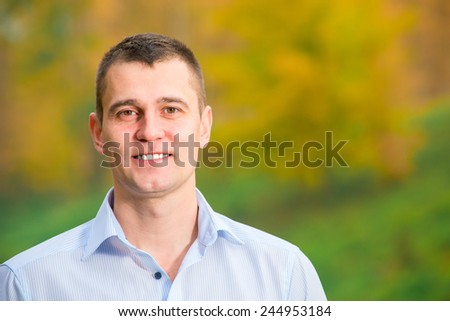 portrait of a smiling man 35 years in the park - stock photo