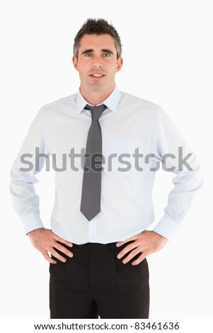 Portrait of a smiling manager posing against a white background