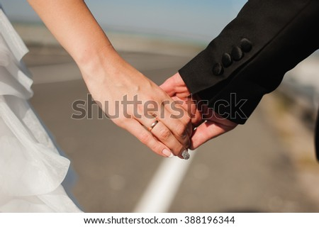 Portrait of a smiling married couple walking on a countryside road