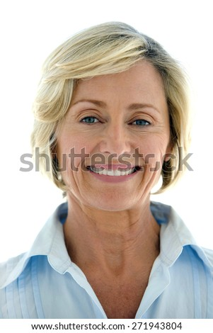 Portrait of a smiling mature woman over white background  - stock photo