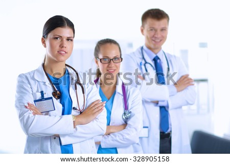 Portrait of a smiling medical team standing with their hands crossed.