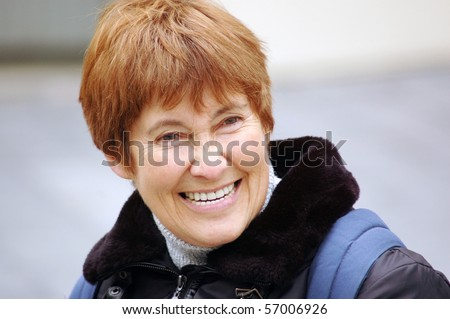 Portrait of a smiling middle-aged women.