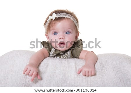 Portrait of a smiling 6 month old baby girl isolated - stock photo