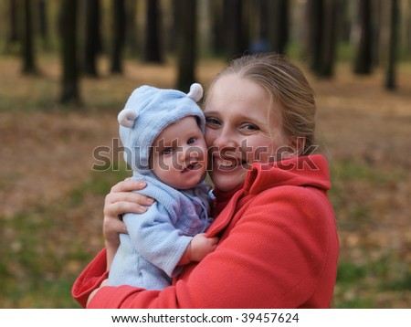 Portrait of a smiling mother with her baby