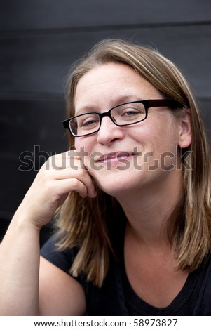 Portrait of a smiling, natural woman - stock photo
