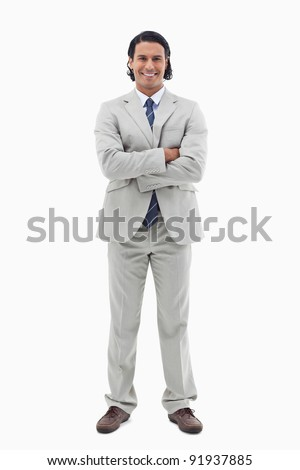 Portrait of a smiling office worker posing with the arms crossed against a white background