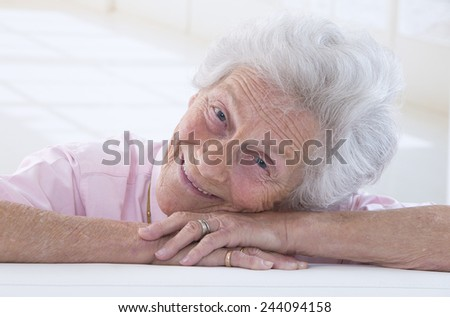 Portrait of a smiling old woman closeup - stock photo