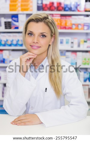 Portrait of a smiling pharmacist looking at camera in the pharmacy