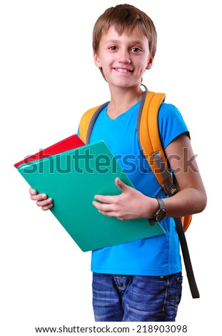 Portrait of a smiling pupil of grade school with backpack and books posing. Isolated over white background. Education concept - stock photo