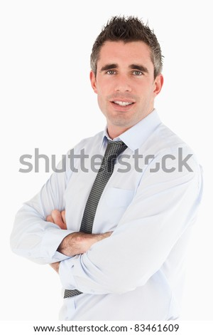 Portrait of a smiling salesperson posing against a white background